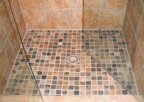 Custom Travertine Shower w/ Smaller Tiles for Flooring